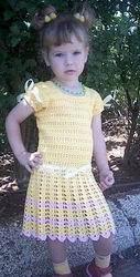 Такое платье подойдет на девочку двух лет. Для вязания
